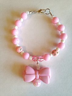 Hey, I found this really awesome Etsy listing at https://www.etsy.com/listing/232922469/kawaii-pink-acrylic-bow-beaded-bracelet