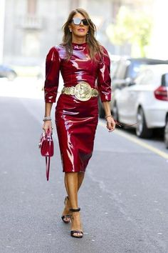100 best dressed of 2014 - Anna Dello Russo in a deep red patent leather midi dress + oversized gold belt