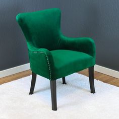 This Arm Chairs feature Dutch velvet upholstery and durable wood construction. These chairs are extremely sturdy and comfortable. They come in an assortment of colors with chrome nail head trim and are a great transitional style.