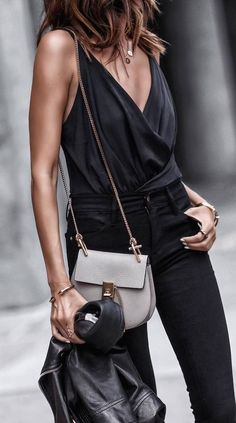 A black top with a v neck AND a slit