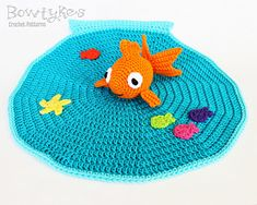 Designer notes: All kids love watching fish, why not make them one to carry around too? Try using snaps or Velcro to attach the fish so your little one can remove it to play and then put it back in the bowl!  Paid crochet pattern.