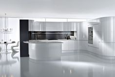 Kitchen  White  Crystal  Chandelier  Circle  White  Gloss  Dinning  Table  Featuring  Curl  White  Gloss  Chair  White  Floor  Artika  Kitchen  In  Curve  Black  Gloss  Kitchen  Island  And  Cabinet Gorgeous Artika Kitchen From Pedini London