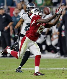 Arizona Cardinals wide receiver John Brown catches a touchdown pass as Philadelphia Eagles corn. Cardinals Football, Nfl Arizona Cardinals, Pittsburg State, Carson Palmer, First Down, Wide Receiver, Football Helmets, Victorious, Photo And Video