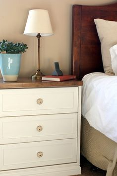 RAST dresser from IKEA transformed to a beautiful nightstand - added base molding lattice for trim, tray top stained with 1/2 English Chestnut and 1/2 Special Walnut, paint and knobs