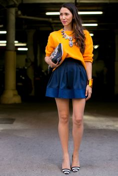 Very lady, and very colorful. Orange and blue at the NYFW.