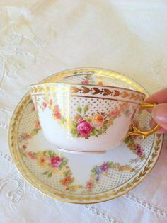 This Tea Cup and Saucer is so pretty with roses, gilding,various designs and delicacy.