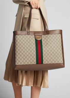 Gucci tote bag in soft GG Supreme crafted from a coated microfiber fabric with leather trim. Green and red Web and GG stud detail.Interior leashed zip x x in Italy. Gucci Handbags, Kate Spade Handbags, Luxury Handbags, Designer Handbags, Designer Purses, Canvas Shoulder Bag, Small Shoulder Bag, Shoulder Straps, Gucci Tote Bag