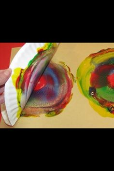 Paper plate painting! Just swirl different colored  paint in a circle on a paper plate, then turn over and paste!