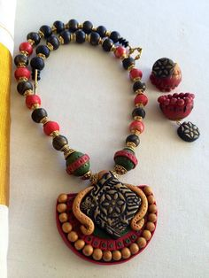 You simply MUST go check out the incredibly beautiful polymer clay  jewelry crafted by Deepa Pulickal https://www.facebook.com/deepa.pulickal