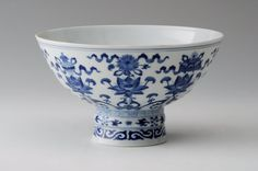 A Chinese Imperial porcelain blue and white Stem Bowl, Qianlong seal mark and period, 1736-1795, painted on the exterior with the Eight Buddhist emblems, each above a lotus bloom, the interior with a shou character, set on a foot of ammonite scrolls, florets and 'S' scrolls, six character seal mark of Qianlong, rim ground and restored, 18.5cm diameter