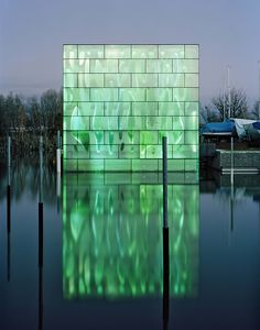 "Baumschlager Eberle, ""Nordwesthaus Building"", color changing LEDs behind glass curtain wall, Lake Constance, Switzerland."