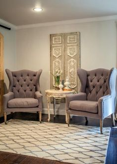 As+seen+on+Fixer+Upper,+the+sitting+room+has+a+very+elegant+look+with+its+high+backed+chairs.