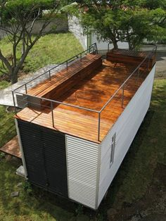 Deck on top of a metal shipping container studio.