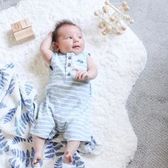 """How has it been a month already? Please slow down as I want to enjoy every minute of this baby goodness...where cuddles are endless and each day is a new discovery."" If mothers could have just one wish (other than more sleep!!) we're certain it would be to slow down time. Photo cred: @jennifergizzi1 . . . #momlife #babiesofinstagram #babyinspiration #happymama #letthembelittle #precious #newborn #baby #boy #instagood #instalove #unitedinmotherhood #organic #muslin #swaddle #blanket…"
