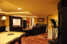 Game room - billiards & movie theater plus exercise room next to each other. Good idea, nice colors.