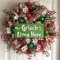 The colorful and fun grinch wreath will be a great addition to your holiday decor. So cute! Made with red and green deco mesh and decorated