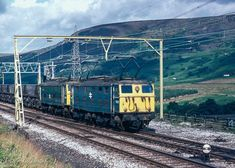 """Two class 76 electrics approach Torside level crossing in Longdendale in the Peak District, returning a train of empty coal hoppers back across the Pennines in August The line closed to passengers in 1970 and freight in Electric Locomotive, Diesel Locomotive, Electric Train, British Rail, Old Trains, Peak District, Love Photography, Abandoned, Britain"