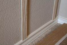 Use lattice boards to allow your board and batten to sit on existing baseboards...Genius!  Saves time and money