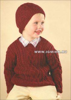 Un suéter caliente y gorra con los patrones de Aran para un niño de 3 años. Radios