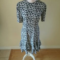 Sale!! LIZ PETITES  DRESS Super Cute dress, black with white flower pattern  and couple  of ruffles at the bottom Liz Claiborne Dresses Midi