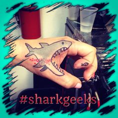Shark feeding concept tattoo that is Jawsome