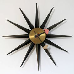Vintage original George Nelson sunburst, spoke, spike clock 2202. Design by George Nelson & Associates.