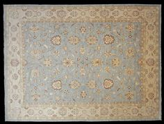 Agra design, Afghanistan - The ground colour of this carpet is a lovely soft eggshell blue tone.  A finer carpet using all hand-spun wool and vegetable dyes woven using a traditional agra design.