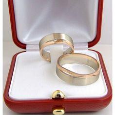 Obrączki z białego i czerwonego złota w damskiej założony brylant. Wedding rings made from red and white gold .