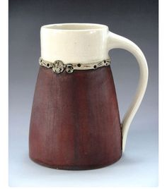 Cup with a red iron oxide skirt and snazzy belt. I'd wear that!