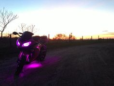 Pink 2013 Kawasaki Ninja 300 with LED under glow kit.