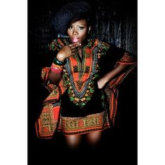 """Traditional Print Dashiki Each dashiki has a hue, and a soft, roomy feel. Fits up to a 52"""" bust and 33"""" length. The border color on the dashiki may vary from the picture. One size fits all."""