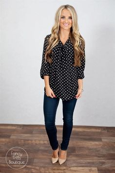 This polka dot top will be your new favorite addition to your Spring wardrobe. It's super light weight chiffon material is so comfortable and high quality. The buttons down the front gives you that extra added style along with the more v neck look and tie at the neck. Dress this casual or dressy, either way it's perfect for the season!Sizing: SM 0-4Med 5-8Large 8-12Model is wearing a size small. Fits true to size.