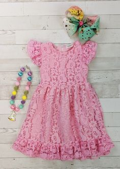 Flutter sleeve lace dress in pink. Zip back. Our lace dresses are not as stretchy as most of our other sizes, so size up if on the edge or in unsure. Any accessories shown are not included. Toddler Boutique Clothing, Wholesale Children's Boutique Clothing, Girls Boutique, Lace Dress With Sleeves, Short Sleeve Dresses, Lace Dresses, Cut Out Leggings, Denim Overall Dress, Cute Girl Outfits