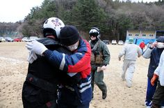 Sailor is embraced by Japanese citizen after delivering supplies., via Flickr.