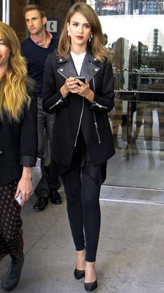 Jessica Alba from Celebs in Coats You can't go wrong with an all-black coat that goes with just about everything, but we suggest covering up in one with cool detailing, like the leather lapels on the actress' Sandro topper.