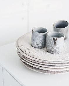 ceramic cups, plates, white walls