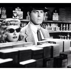 """Double Indemnity. Classic Film Noir!  Co-Written by Billy Wilder & Raymond Chandler. 1944. Starring Fred MacMurray, Barbara Stanwyck & Edward G. Robinson. Deemed """"culturally, historically, or aesthetically significant"""" by U.S. Library of Congress, 1992, Double Indemnity was selected for preservation in National Film Registry. 1998, ranked #38 on American Film Institute's list of 100 best American films of 20th century; '07   #29 on AFI's 10th Anniversary list. ~Repinned via Stephanie Mazzeo…"""
