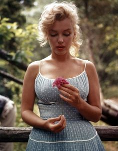 Marilyn. I think this is the softest, most innocent photo i have seen of Marilyn. Love it.