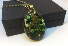 Timeless green oval steampunk pendant humming bird jewellery