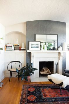love the curves + that chair + that grey wall...