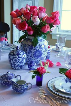 blue and white with hot pink roses, like the petals on the cloth