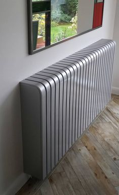 Glossy Silver Radiator Cover: industrial Living room by Cool Radiators? It's Covered! Metal Industrial, Industrial Interiors, Industrial Living, Vintage Industrial, Industrial Bathroom, Industrial Closet, Industrial Bookshelf, Industrial Apartment, Industrial Office