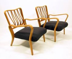 """A pair of 1950s bentwood """"Linden"""" armchairs by British designer G A Jenkins for Packet Furniture."""