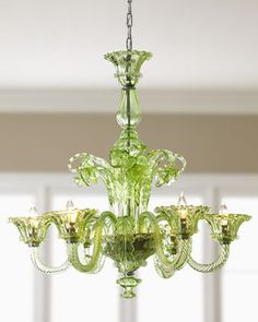 Murano-style glass chandelier features gracefully curved arms and floral- and acanthus-leaf-motif decoration.        From Cyan.      Made of blown glass with an applied green color.
