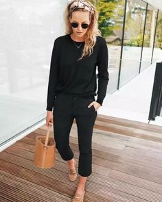 Black skinny jeans or pants, black sweater, cognac slides or black slippers, scarf worn in the hair. Could also sub green pants for the black