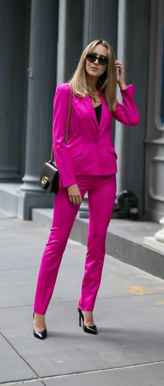 Top 10 Spring Trends to Know // Trend #4: PINK // click the image for all the details! // neon vibrant fuchsia pink mugler pant suit, black silk cami, gucci bag, ysl classic pumps