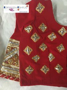 Traditional bijya looks great on this classic Gota blouse.