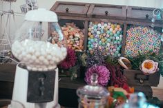 Vintage style lollie buffet with flowers in the open draws. Wedding