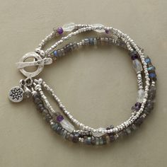 "STORM CLOUDS BRACELET -- A multi-strand gemstone toggle bracelet, in which the storm cloud colors of labradorite, moonstone and amethyst are shot through with the radiance of sterling silver beads. Toggle clasp. Exclusive. Handcrafted in USA. Approx. 7-1/2""L."