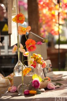 beautiful colors... love the skinny necks of these vases and tall, thin flowers.